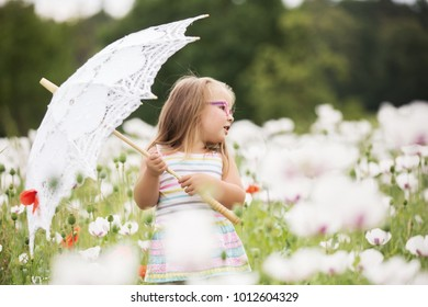 Young lady smiles among hundreds of red flowers around