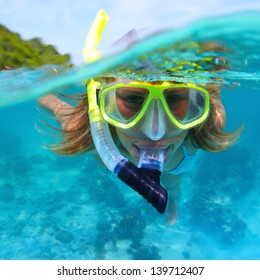 Young lady snorkeling in a tropical sea