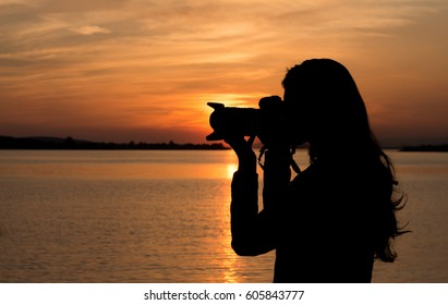 Young lady taking photo