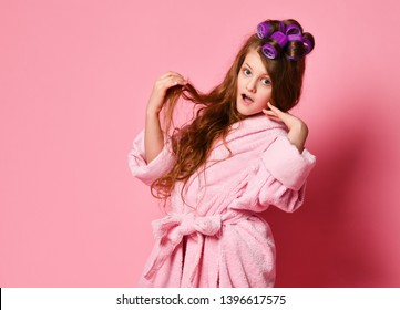 Young lady or teen girl in spa salon is surprised or frightened with her hair style condition. Acts like picky insta-model. Beauty concept on pink background