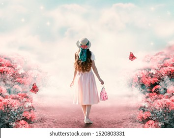 Young lady woman in romantic dress, hat with bag in retro style walking along summer rose field path and flying butterfly. Idyllic tranquil fantasy scene. Travel across fairy tale hills