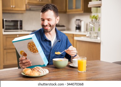 Young Latin man eating breakfast in the morning while reading the cereal box