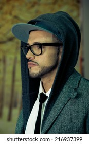 Young latin man wearing glasses and a hoodie side view closeup
