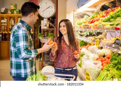Young Latin newlyweds shopping together and buying some healthy food