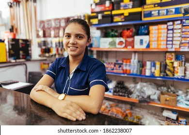 Young latin woman working in hardware store