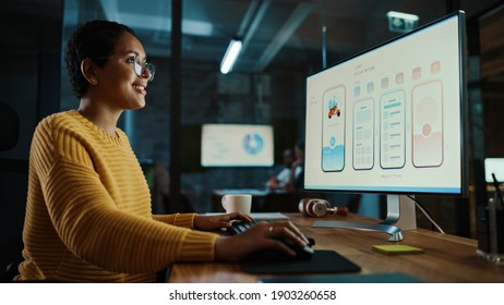 Young Latina Designer Working on a Desktop Computer in Creative Office. Beautiful Diverse Multiethnic Female is Developing a New App Design and User Interface in a Digital Graphics Editing Software.