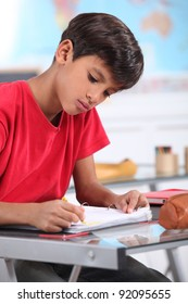 A young Latino studying.