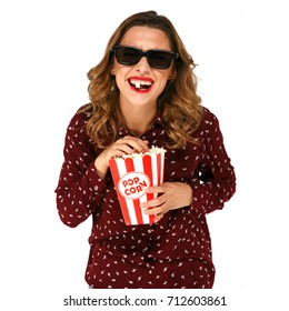 Young laughing  woman with popcorn watching interesting comedy movie in stereo glasses. White isolated background.