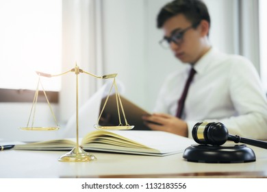 Young lawyer business man working with paperwork on his desk in office.