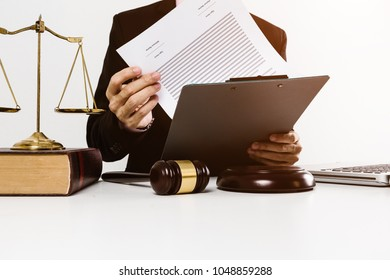Young lawyer confident vintage style with gavel and contract paper signing put on white desk table.