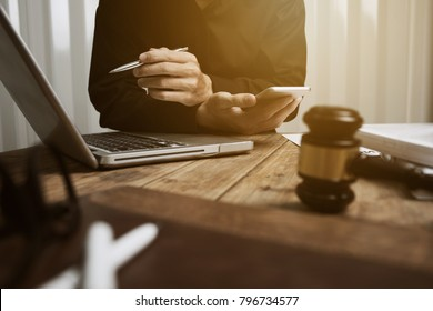 Young lawyer working hard alone in his office.