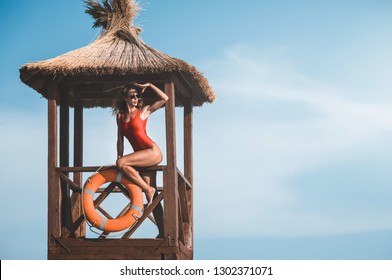 young lifeguard woman on the tower. baywatch.
