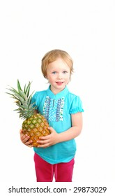 Young little blue ayes girl with big pineapple isolated on the white background. That' is concept for healthy food.
