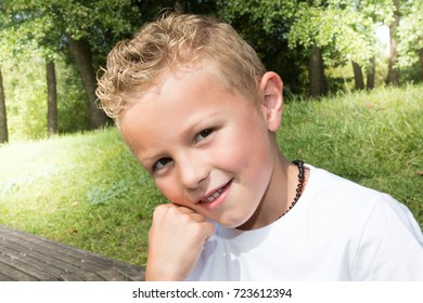 young little boy outdoors on the grass Child face close up
