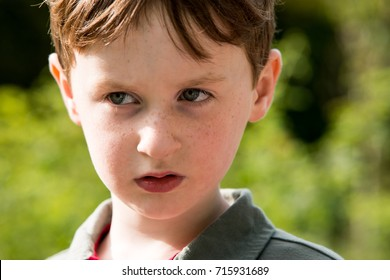 Young little boy portrait looking at something