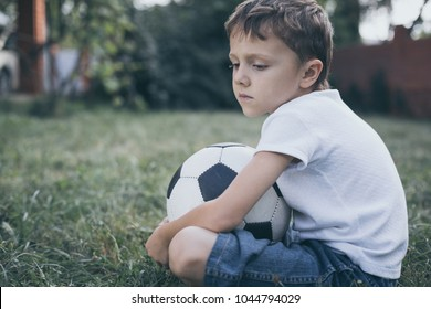Young little boy standing  with soccer ball. Concept of sport.