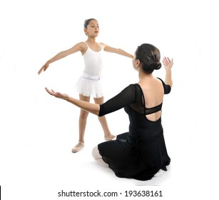 young little girl ballerina learning dance lesson with female ballet teacher
