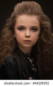 Young little girl posing like a fashion model