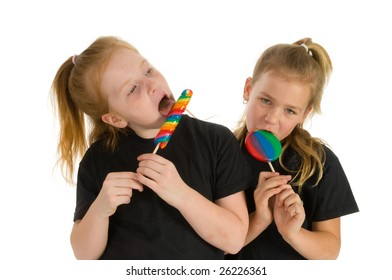 Young little girls with colored lollipops