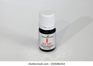 Young Living Essential Oils, Red Shot blend, isolated on a white background - San Antonio, Texas, USA - September 15, 2019