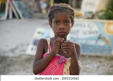 Young local girl posing at the front of african art market in Nungwi, Zanzibar