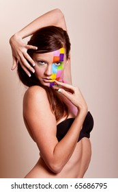 Young long hair brunette girl with colorful fashion makeup