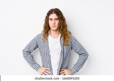 Young long hair man posing isolated confident keeping hands on hips.