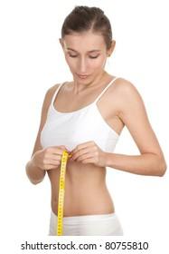 young, long hair woman measuring her waist