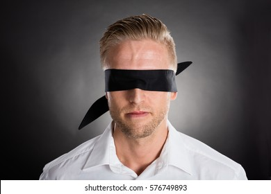 Young Lost Businessman With A Black Blindfold