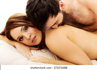 Young love couple in bed.