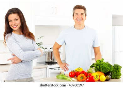 Young love couple cooking at the kitchen