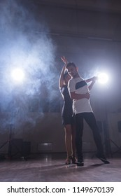 Young love couple dancing social danse kizomba or bachata.