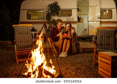 Young love couple hugging by the campfire, picnic