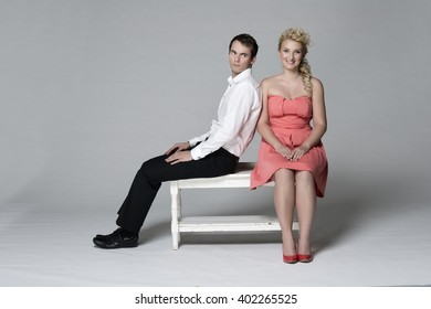 Young love couple sitting on the bench