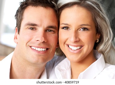 Young love couple smiling at home