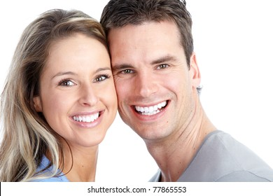 Young love couple smiling. Over white background