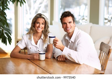 Young love couple taking breakfast  in the comfortable apartment
