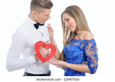 Young lovely couple holding red heart together