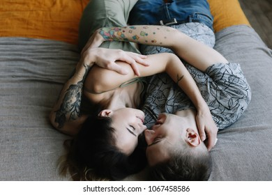 Young lovely couple lying in a bed. Man and woman embracing in bed.