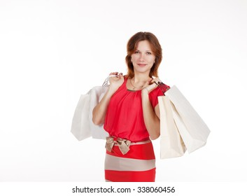 young lovely woman in red dress and shoes with shopping bags closeup