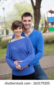 Young lovers dressed in blue looking at camera