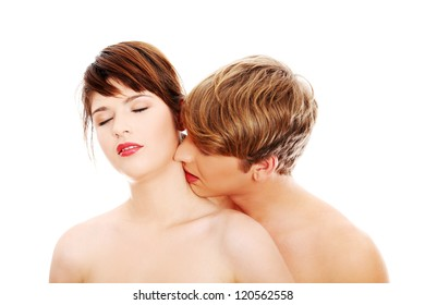 Young lovers intimate kiss
