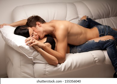 young lovers kissing on the couch