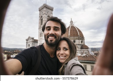 Young lovers visiting Florence in Italy and taking a selfie
