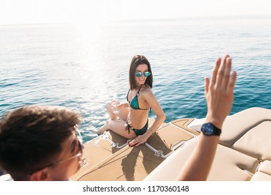 Young loving couple of caucasian people chilling on the modern yacht deck. Sailing the sea.
