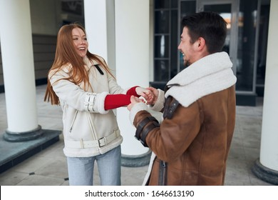 young loving couple holding hands and laughing, man makes woman happy, date, guy asking girl to be his wife. All you need is love - Shutterstock ID 1646613190