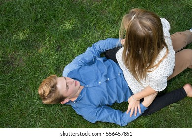 young loving couple playing with in grass