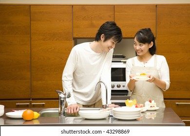 A young loving couple in their kitchen
