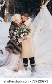 Young loving fashionable beautiful wedding couple outdoor in winter in a stylish fur coat. Beauty, happiness, love, seasons concept