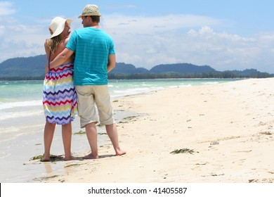 Young loving honeymooners on tropical sand beach